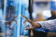 Man touching retail display with right hand
